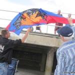 John Barresi checks out one of Olver Reymond's kites...