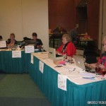 Volunteers busy tracking auction sales...