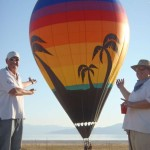 Steve de Rooy and Bazzer Poulter eyeball a Rum Buddy styled balloon...