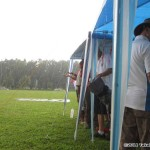 Clinic participants under cover from the rain...