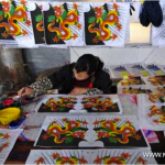 A craftswoman makes kites in Weifang, east China's Shandong Province, April 18, 2011. Photo: Xinhua
