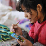A woman makes kites in Weifang, east China's Shandong Province, April 18, 2011. Photo: Xinhua