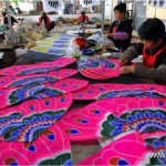 Craftswomen make kites in a kite factory in Weifang,  east China's Shandong Province, April 18, 2011.  Photo: Xinhua
