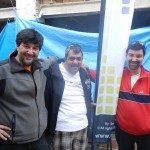 Ben with Pedro (L) and Esteban (R), showing off the new banner they made for him.