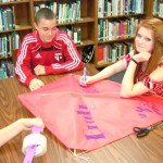 L/R   Zac Benton, Brooke Strickland make some interesting drawings on their kite.  Why be dull?