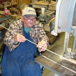 Bobo Mercer uses a special kite stick jig to help steady the stick for a notch cut.
