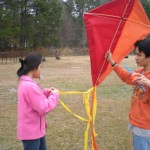 L/R  Tenth graders Tina Greene and Brian Greene are twin brother and sister.  Their two tone kite really lit up the sky but now they are trying to untangle their kite with multiple tails.  You can handle it guys.