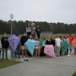 Mrs. Kemp (left) stands with  her 6th period class around the Waccamaw Warrior ending a fun and successful kite day where all of Mrs. Kemp's classes flew kites with 100% of all kites flying high.  Ahh, this must prove that the kites were of good symmetry and congruent.  Personally, I think it was just fun.  Way to go Mrs. Kemp and classes.
