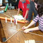Ninth grader Brittany Wheeler places a pipe cleaner on the two kite sticks to hold them together.  This is a quick way to place two sticks together and take them apart or to replace a broken stick.