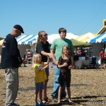 Dean Jordan shares his kite and fun with young spectators