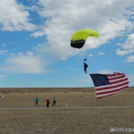 Paraglider coming in with US flag on display