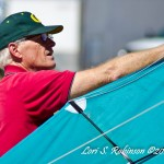 Ron Bohart makes some kite adjustments