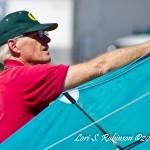 Ron Bohart makes some kite adjustments