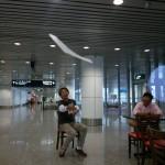 001 - Naoki Tamura, doing it sitting down at KL Airport