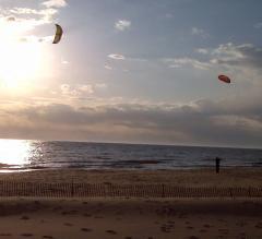 Kites over Lake Michigan at sunset