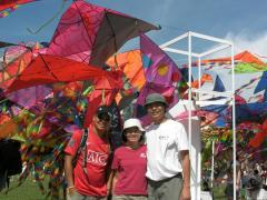 Ken, Lee Cher and Steven... in front of the kites made by students.