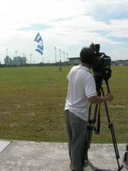 Peter with a zero-wind indoor Rev, being filmed by the MediaCorp camera man