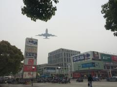 Planes fly close overhead near the hotel