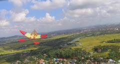 Dieu Sao flying above rice fields and villages